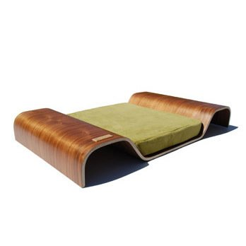 BENT PET BED  Inspired by the Eamses' LCW, the bent platform bed imitates the molded plywood and walnut finish of the classic chair. Only available in small, so its best suited for a cat or toy dogs.