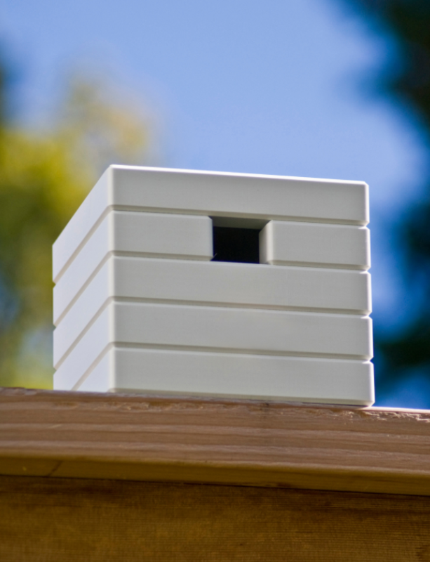 "The modern, clean design of this birdhouse provides ""simple avian living"". The eight color choices give you a chance to draw as much or as little attention to this nest as you like."