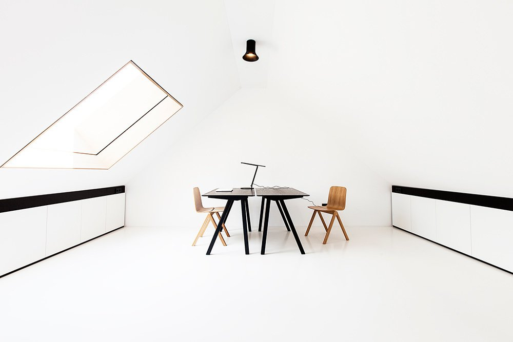 In the top floor study area, a pair of Copenhague Desks by Ronan & Erwan Bouroullec for HAY are stationed below a Sax hanging light by Vertigo Bird.  A Strikingly Minimal Home Built in Less Than Six Months by Tiffany Jow from House of the Week: Minimalist Dream Home with an Asymmetrical Pitched Roof
