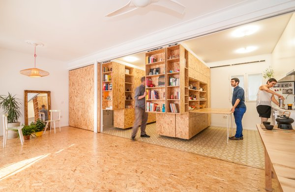 Storage Room and Shelves Storage Type The unit can be configured to allow room for meal preparation around a built-in kitchen.  Best Photos from Sliding Shelves Transform This Tiny Home Into Countless Configurations