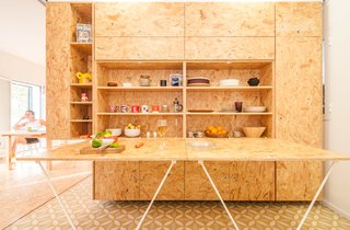 A drop-down countertop conceals dishware and other kitchen belongings.