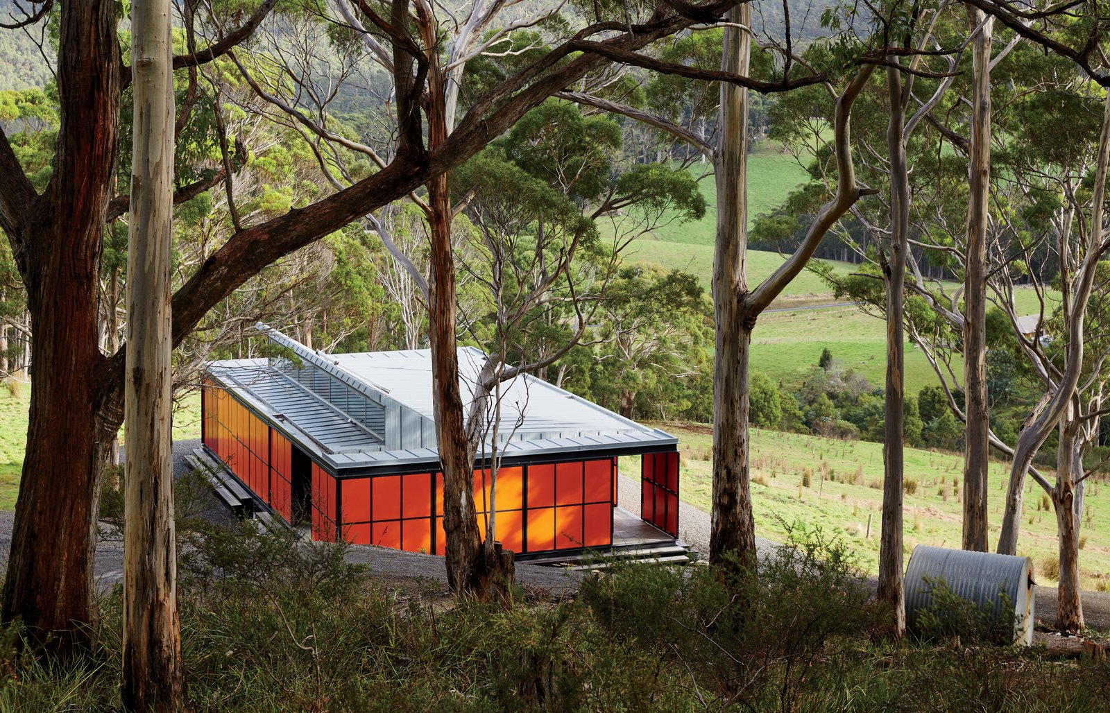 Exterior and House Building Type Upon his first visit to Tasmania, an island south of the Australian mainland, resident David Burns was immediately smitten with its varied, pristine landscape. Working with architecture firm Misho+Associates, he built a self-sustaining, 818-square-foot retreat that would allow him to completely unplug from urban life.  Best Photos from An Off-the-Grid Prefab that Combines Open Plan Living with Rugged Durability