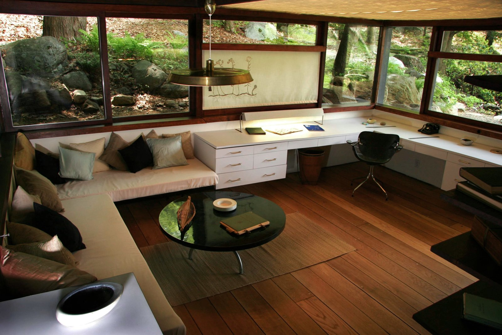 Wright's studio, enveloped by windows, sits at level with the landscape around it.  Photo 4 of 9 in The Remarkable Home of Modernist Designer Russel Wright