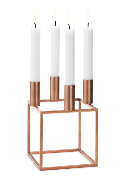 "Kubus 4 in Copper by Mogens Lassen, $225  8"" H x 5.5"" W x 5.5"" D  Designed in 1962 by the Danish architect as a limited-edition gift for close friends, Kubus is in production again thanks to the Lassen family, who recently introduced a copper-plated steel version. dwr.com"