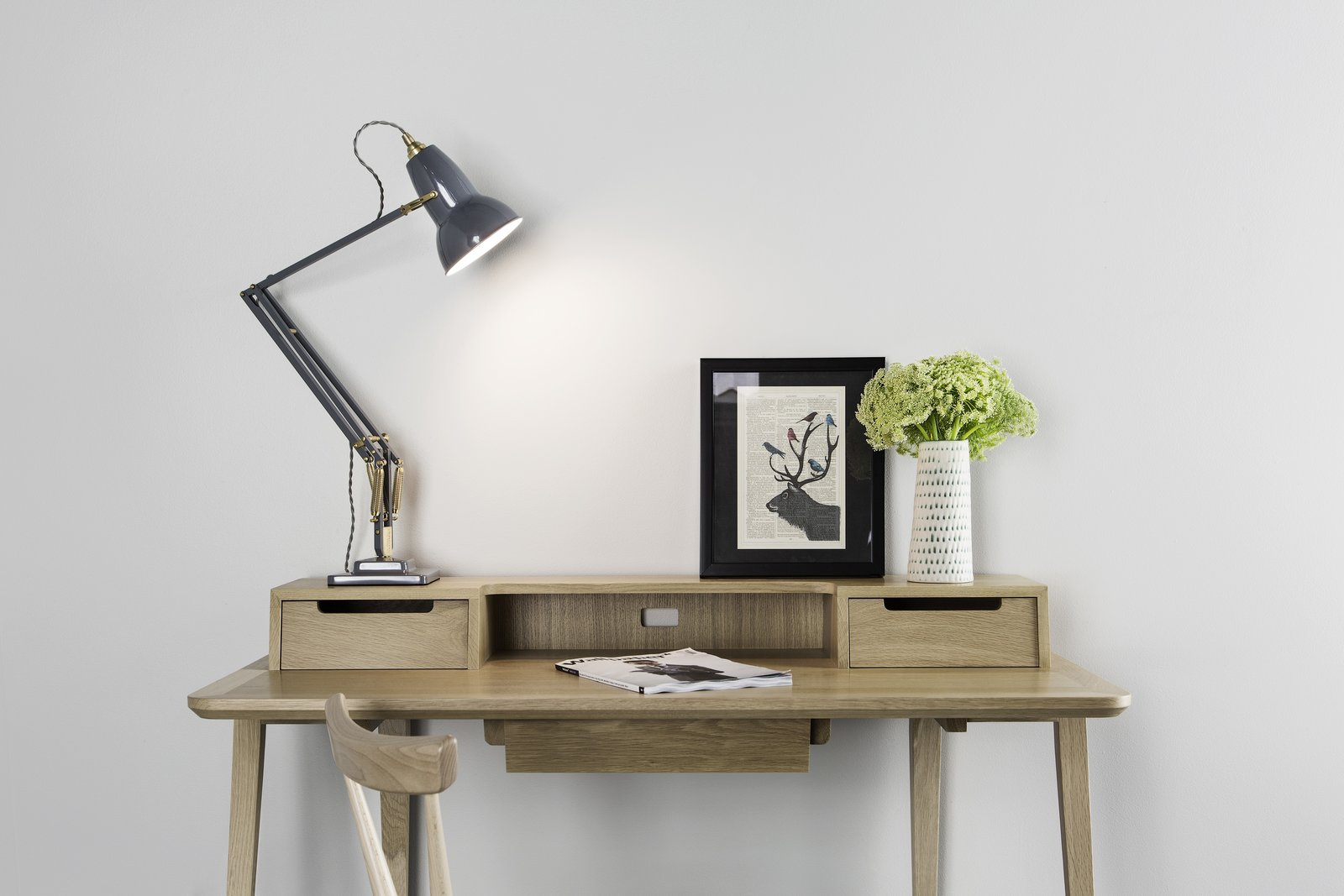 Office, Desk, Lamps, and Chair The newly released Original 1227 Brass Desk Lamp in Elephant Grey is at once minimalist and statement making.  Classic Desk Lamp from 1934 Remade with Modern Details by Marianne Colahan