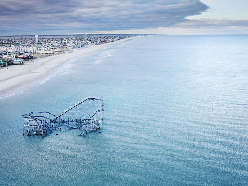 From Stephen Wilkes, the roller coaster from the boardwalk in Seaside Heights, New Jersey, partially submerged in the ocean after Hurricane Sandy.  Seaside Escaping from Discover How Parks Can Protect Cities from Natural Disasters at Dwell on Design New York