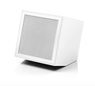 Prism by Lexon, $55.  This adorable clock radio and rechargeable speaker designed by Joe Doucet appears to recline backward on whatever surface it rests.