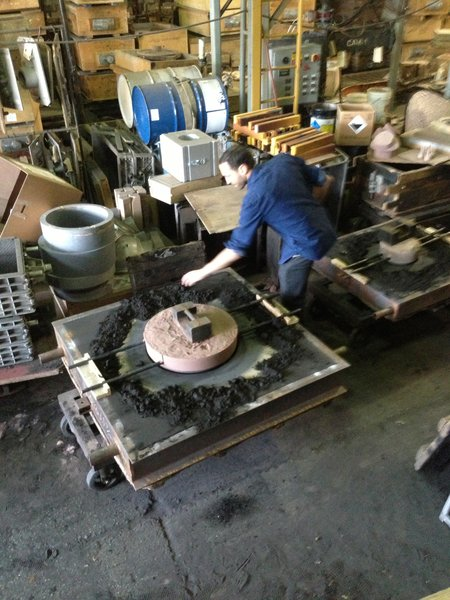"""The Bocci 19 series is made with a sandcasting technique, which Arbel favors because it creates a unique product each time. """"Our jobs as designers now is to build systems with enough looseness in them so that they result in different pieces"""" he explains. Here, Arbel checks the mold before the molten metal is brought in."""