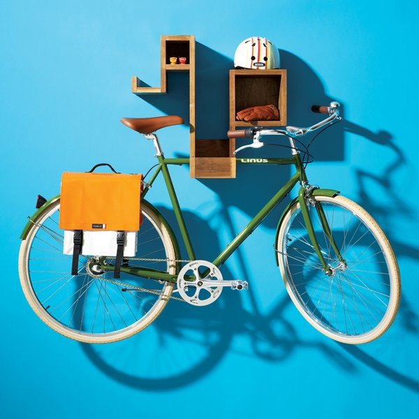 Pedal Pod, a wall-mounted shelving unit designed by Tamasine Osher, provides a compact and tidy way to store both your accessories and bicycle while keeping it off your floors.