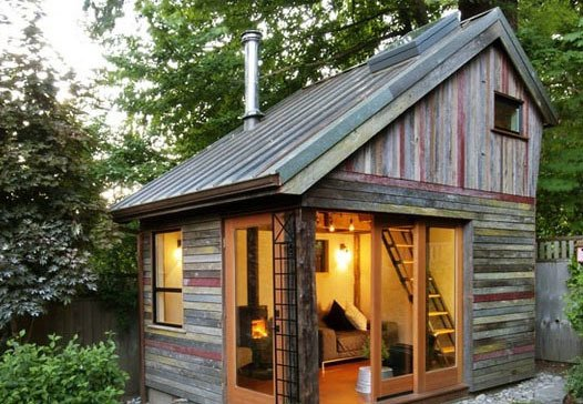 Exterior, Saltbox RoofLine, Cabin Building Type, Metal Roof Material, Wood Siding Material, and Tiny Home Building Type A polychrome facade made of salvaged, 100-year-old barnwood gives this small, lofted cottage space its unique character. Its copper roof is also reclaimed, a lucky Craigslist find from a local remodel. Though the structure has a footprint of just 11' x 14', it provides a useful space to entertain, catch up on work, or relax.  Outdoor from Backyard Escapes and Retreats We Love