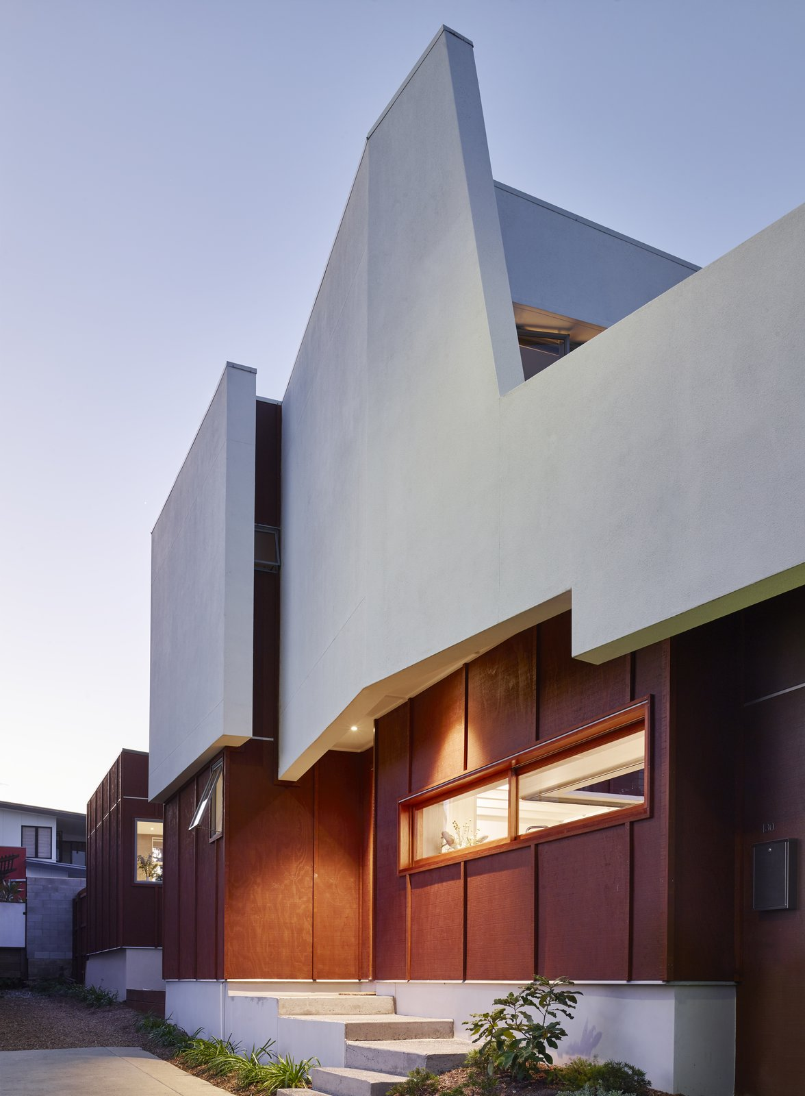 """""""At the front door, the house is only six feet wide and opens to the north-facing landscape behind, providing views out and allowing light in,"""" O'Neill said. The home's uniquely-shaped roof is painted with Taubmans' Crisp White.  Annie Street by Kelly Dawson"""