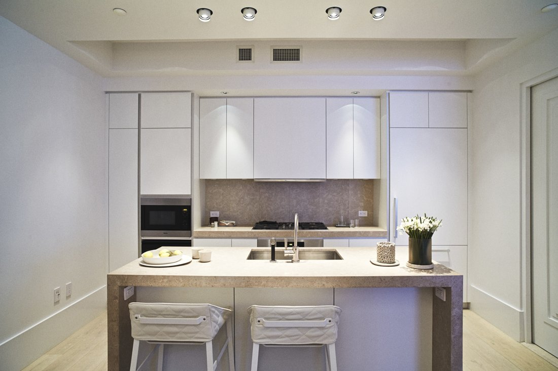 The kitchen of model unit 6C at Huys, 404 Park Avenue South, designed by Piet Boon with Karin Meyn. The kitchen sports white lacquer cabinetry by Bulthaup with a Chambolle marble countertop, Dornbracht fixtures, and Miele appliances.  Photo 1 of 6 in 5 Great Rooms from New Dutch Apartment Huys in New York City