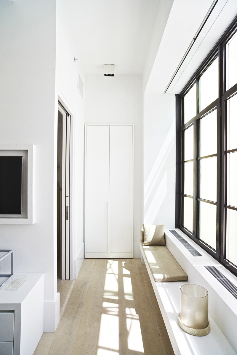 The 58-unit building features custom millwork details, including built-in window seats, dining banquettes, and Piet Boon signature applied closet doors and frames.  Photo 6 of 6 in 5 Great Rooms from New Dutch Apartment Huys in New York City