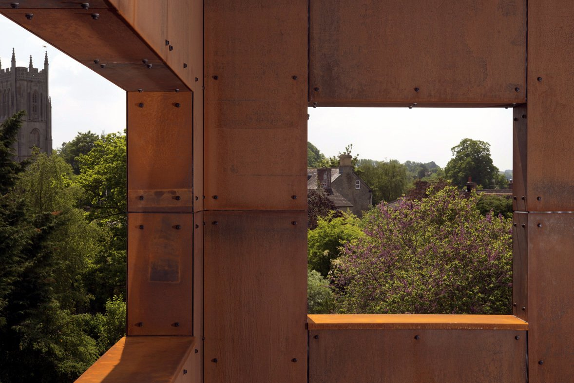 """You become very much more aware of the landscape by putting objects in it,"" says Merer. The historical landmarks of the town are beautifully framed by the angular metal lookouts. The Cor-Ten exterior is corrosion-resistant and will develop a unique surface patina over time.  Ferrum House by Sarah Akkoush"