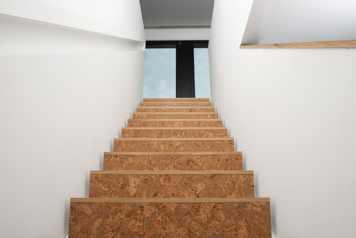 Cork staircases connect each floor of the house, while adding warmth and texture to the home's neutral palette.  190+ Best Modern Staircase Ideas from Ferrum House