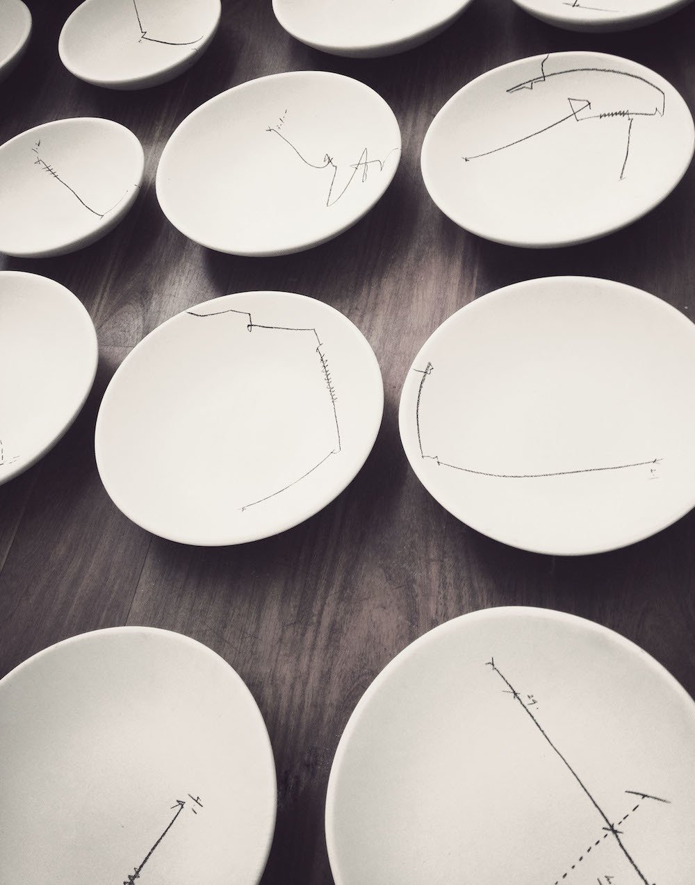 Cadena designed all the dishes, covering them with abstract, hand-drawn patterns inspired by his grandma's silverware.  Photo 5 of 9 in 10,000 Bones Cover the Walls of this Mexico Restaurant