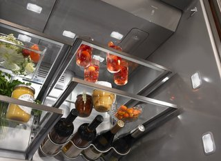 Under-shelf LED lighting improves visibility. The refrigerator is equipped with systems that manage humidity and airflow to keep food fresh and control odors.