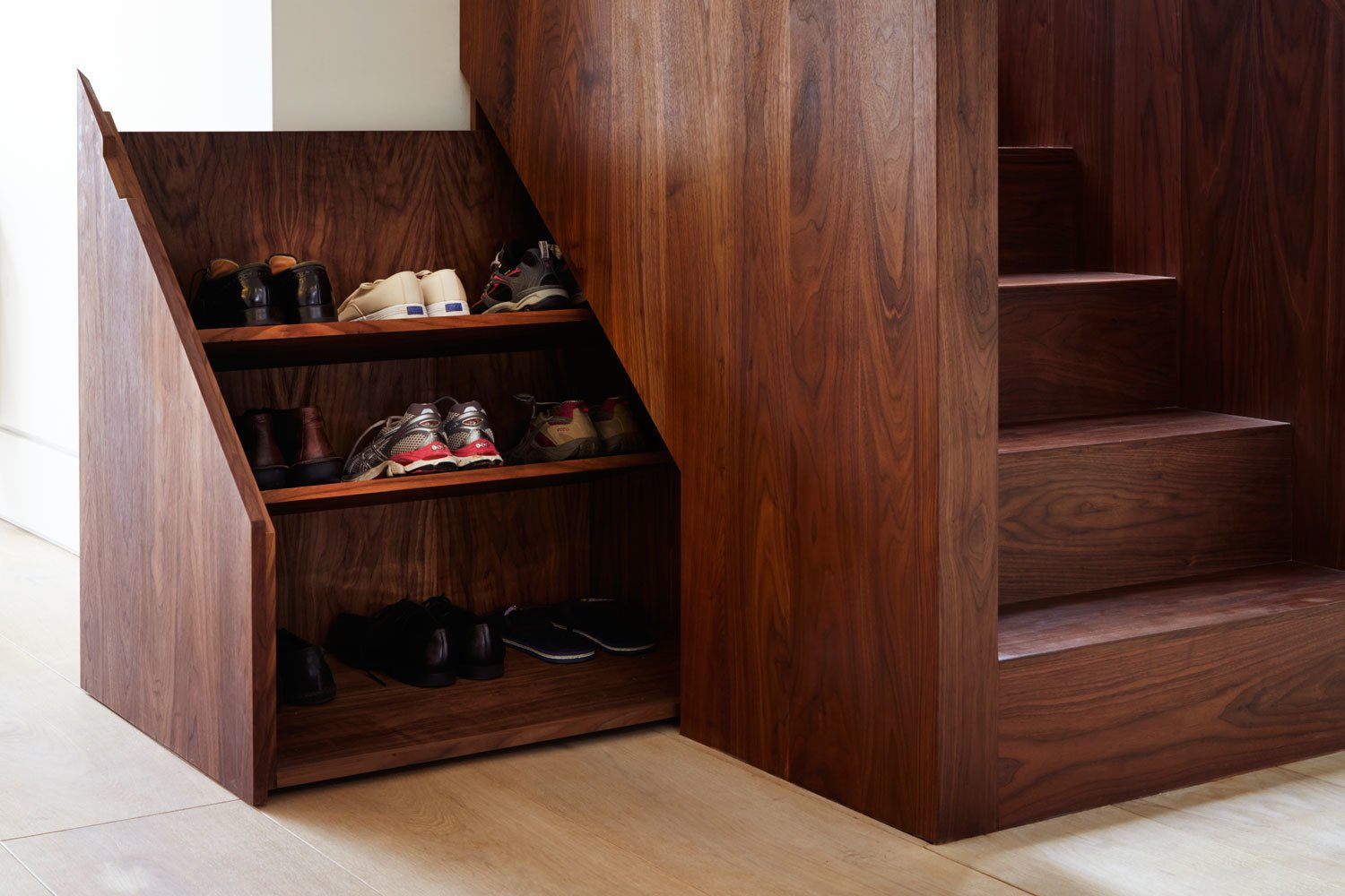 The base of the stairwell includes a hidden compartment to conveniently store shoes.  190+ Best Modern Staircase Ideas from Lantern Home