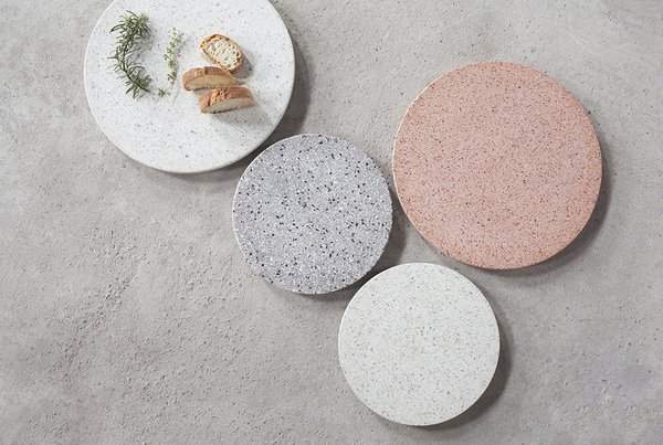 The Terrazzo Platter from Serax is a sophisticated kitchenware accent, and can be used as a serving tray, board for cheese and charcuterie, or even as a centerpiece on a dining room table—it can present tea lights, a vase of flowers, or center another accent. Terrazzo is a composite material that is available in a range of colors and tones and features a distinctive speckling.