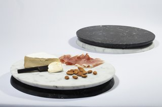Handcrafted in Chicago, the Doppio Serving Tray from Felicia Ferrone is a centerpiece, serving board, and tray, all in one elegant design. Comprised of two sides—one in white Carrara marble and the other in black Nero Marquina, the Doppio Serving Tray can be used to present cheeses and charcuterie, showcase candles or flowers, or can be used as a serving tray for cocktails or snacks.