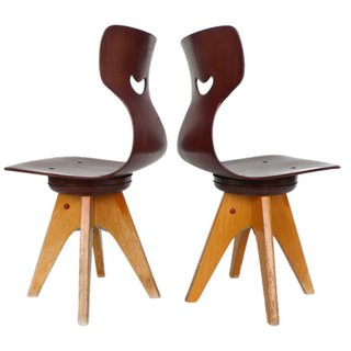 These swiveling and sturdy multi-ply steam-bent wood chairs were created by German furniture designer Adam Stegner and were produced by Pagholz Flötotto in the 1950s. $1,800