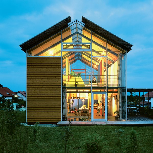"""Architect Reinhold Andris has lived in this house in southwestern Germany since 1998. Fifteen years on, the structure remains emblematic of his modernist perspective. """"It's a very open architecture,"""" he says, noting the near-invisible steel frame and pervasive use of glass."""