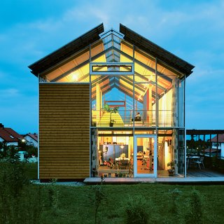 "Architect Reinhold Andris has lived in this house in southwestern Germany since 1998. Fifteen years on, the structure remains emblematic of his modernist perspective. ""It's a very open architecture,"" he says, noting the near-invisible steel frame and pervasive use of glass."