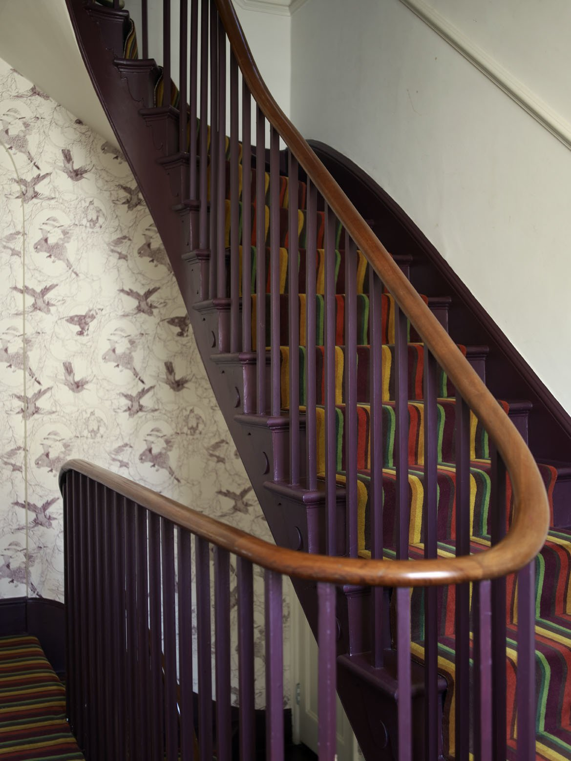 A new, wider staircase replaced the original Victorian version, and links the public and living areas; and the kitchen and the subterranean basement office.  Much of the salvaged materials in the house came from the National Museum of Scotland, and their zoological origins have been picked up in the wallpaper created by Danile Heath, which features drawings of birds being stuffed for display.  Photo 5 of 12 in A Gracious London Terrace House Is Reborn with Salvaged Materials