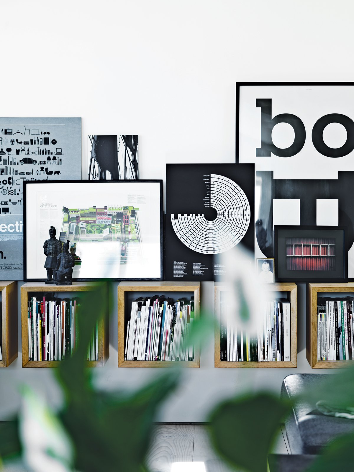 In the main living area, Olsen's own artwork picks up on the graphic diversity of the magazines housed in Boox shelving by Jesper Holm.  Modern Danish Homes We Love from Converted Loft Fit for a Modern Family in Copenhagen