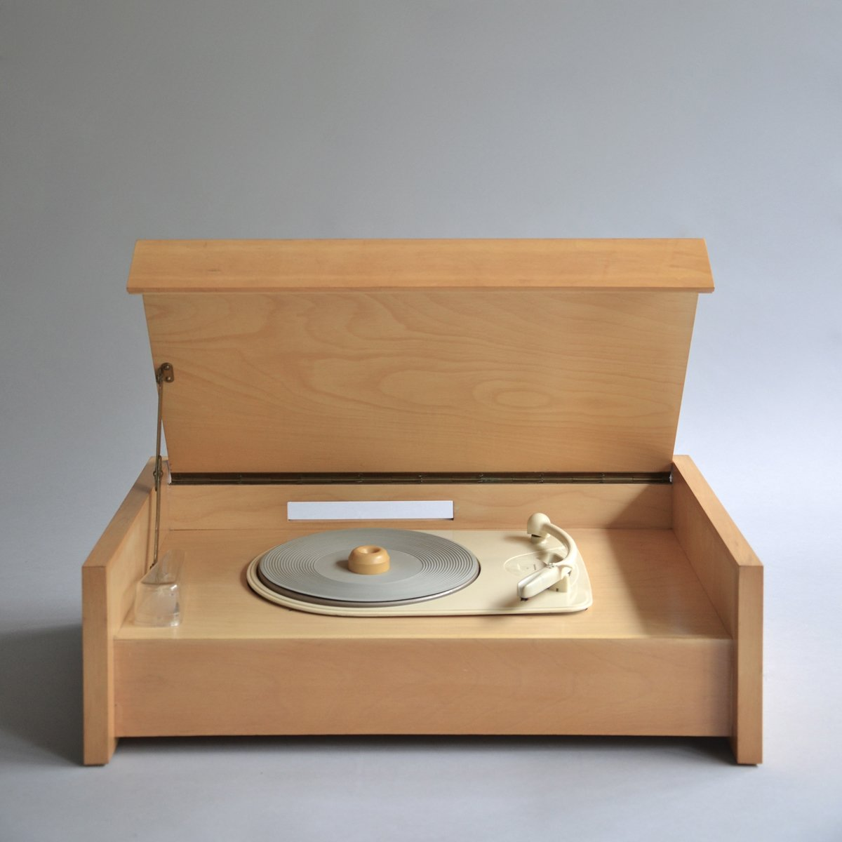"An earlier version of the record player and one of a foundational group of designs produced in 1955, the inaugural year of Braun Design. Braun G 12 (Valvo chassis) by Hans Gugelot, on sale for £650.  ""Although production of Gugelot's G series continued into the early '60s, this vocabulary was soon eclipsed by Ram's development of a less romantic, more affirmatively industrial approach,"" writes Kapos.  Sound Style from Shop the Vintage Braun Catalog from Your Web Browser"