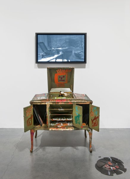 Victrola (2005), Nam June Paik  A graffitied victrola stand paired with a video projection plays with the dichotomy between old and new.