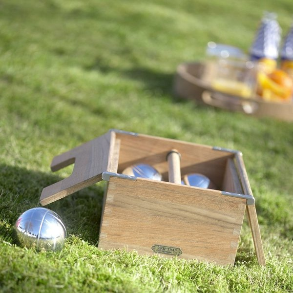 Having a lawn game at your party is a great way to keep guests entertained. A beautifully designed version of the classic lawn game, Pétanque—a French version of Italy's bocce—the Akiko Petanque set includes a set of six chrome boule balls and a target ball, packaged in a teak box for storing and carrying the game.