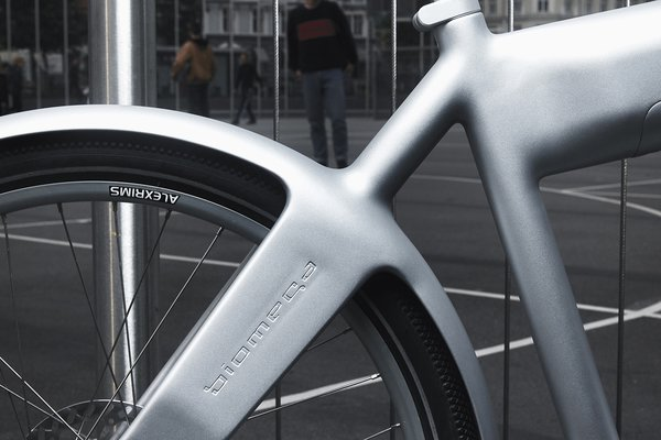 The automatic two-speed bike features hydraulic disc brakes and is available in two colors, silver and white.