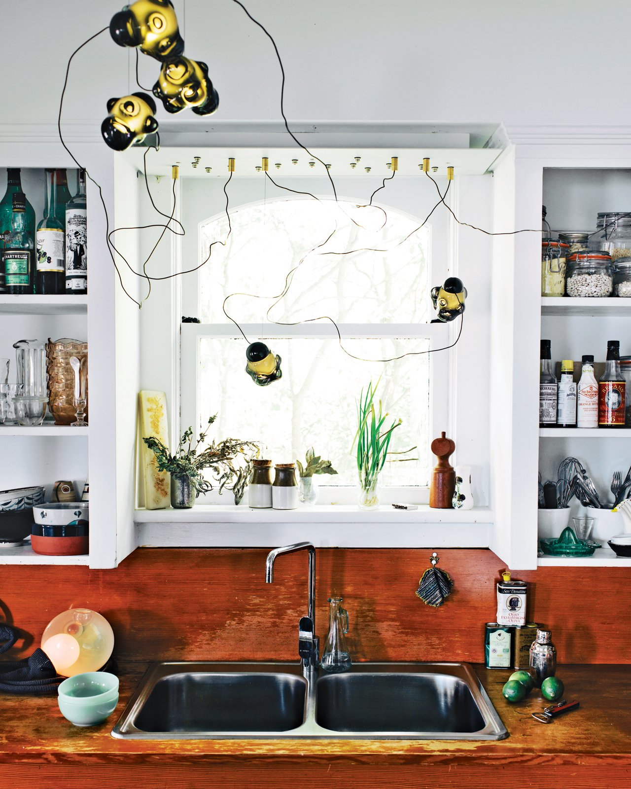 Above the sink in the kitchen, you can see one of Bocci's first 57 chandeliers.  In the Home from Love Animals? This House is for You