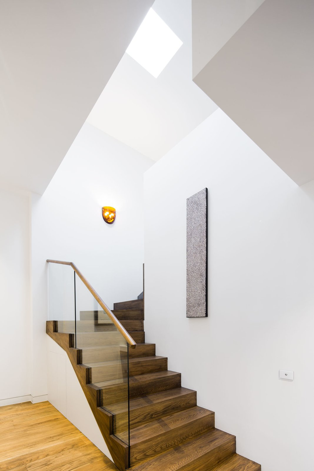 Skylight Window Type, Staircase, Wood Tread, and Wood Railing Here also hardy materials—the dark oak stairs—contrast with clean white walls.  190+ Best Modern Staircase Ideas from A Breezy Modern Addition Opens Up a Historic Melbourne Home