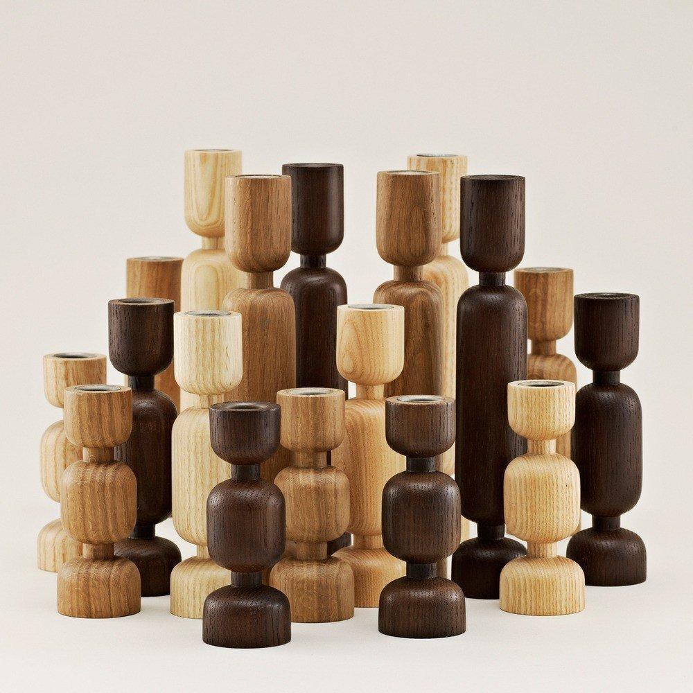 Danish designer Simon Legald was inspired by the silhouette created in a tree trunk as lumberjacks slowly chop away toward its center when he conceived of this series of Lumberjack Candle Holders. Each holder is carved from a single, cylindrical piece of solid wood. The result is a series of candle holders that blend an organic feel and a refined, sculptural quality, making them an ideal choice for a rustic kitchen or elegant dining room.  Modern Candlestick Holders by Marianne Colahan