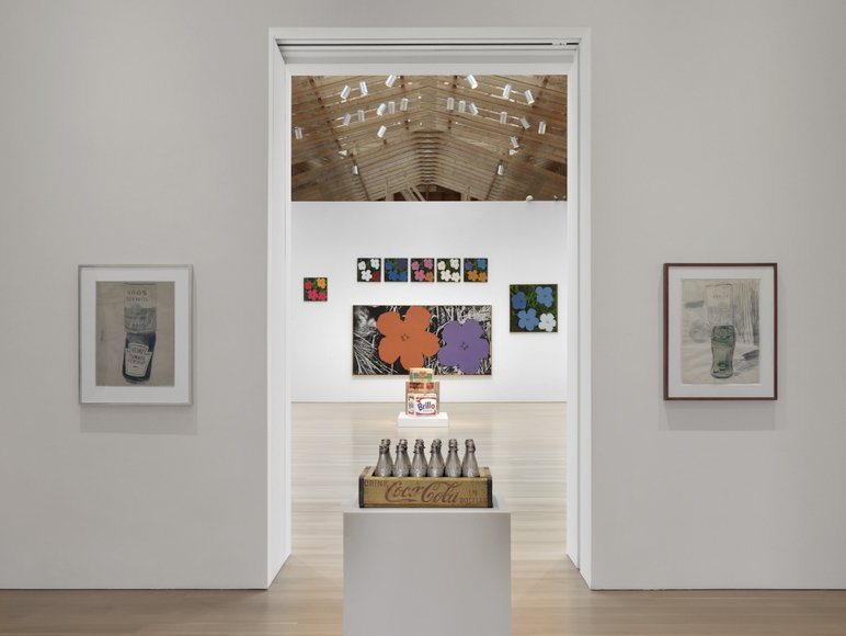From Warhol's famous hyper-color prints of hibiscus flowers (background), to his little known (unreleased) perfume collaboration (contained within the silver Coke bottles in front).  Credit Stefan Altenburger, Courtesy The Brant Foundation  Photo 8 of 15 in Andy Warhol at The Brant Foundation Study Center