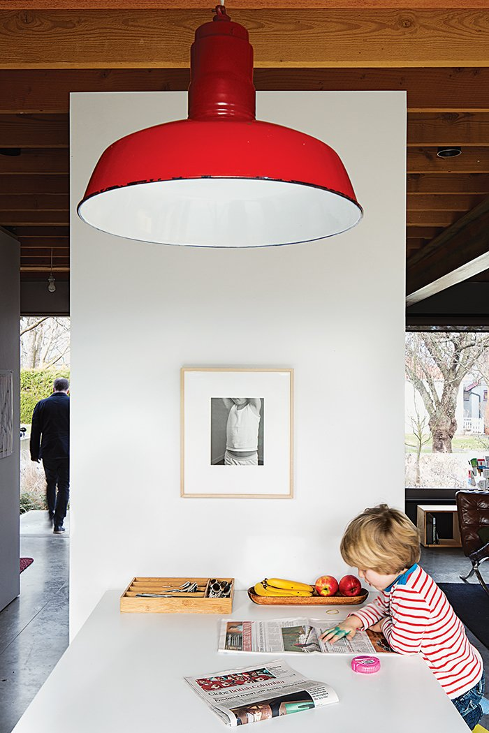 Kitchen and Pendant Lighting The pendant lamp is a vintage find.  Photo 6 of 11 in This Bungalow is Anything but Basic