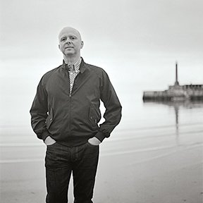 """A longtime Dwell contributor who grew up near the sea and now lives in London, Iain Aitch covers the point where art, architecture, and people meet. Writing about a Swedish surf shack inspired him to dig out the 1963 movie Beach Party, and wonder ifhis own Swedish great-grandfather ever conquered the waves.  Most-admired landscape designer: """"Nek Chand, who built the eccentric Rock Garden in Chandigarh, India, from the rubble created as Le Corbusier's designs were built in that city.""""  Meet the Faces Behind Our Outdoor Issue by Dwell"""