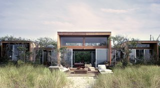 Designed by well-known local modernist Horace Gifford in 1968, this house on New York's Fire Island springs up from the marshy grasses and creates a symmetrical, tripartite summer house with sliding doors to let in cooling breezes.