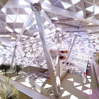 """The King Abdullah Financial District Conference Center is designed as an extension of the angular desert landscape of Riyadh. Now under construction, the building's organic profile and faceted skin integrates the structure into its adjacent terrain. A distinctive steel mega-roof, consisting of 165 triangles and 98 nodes, covers program spaces, minimizes solar gain, and harbors indigenous plant life."""