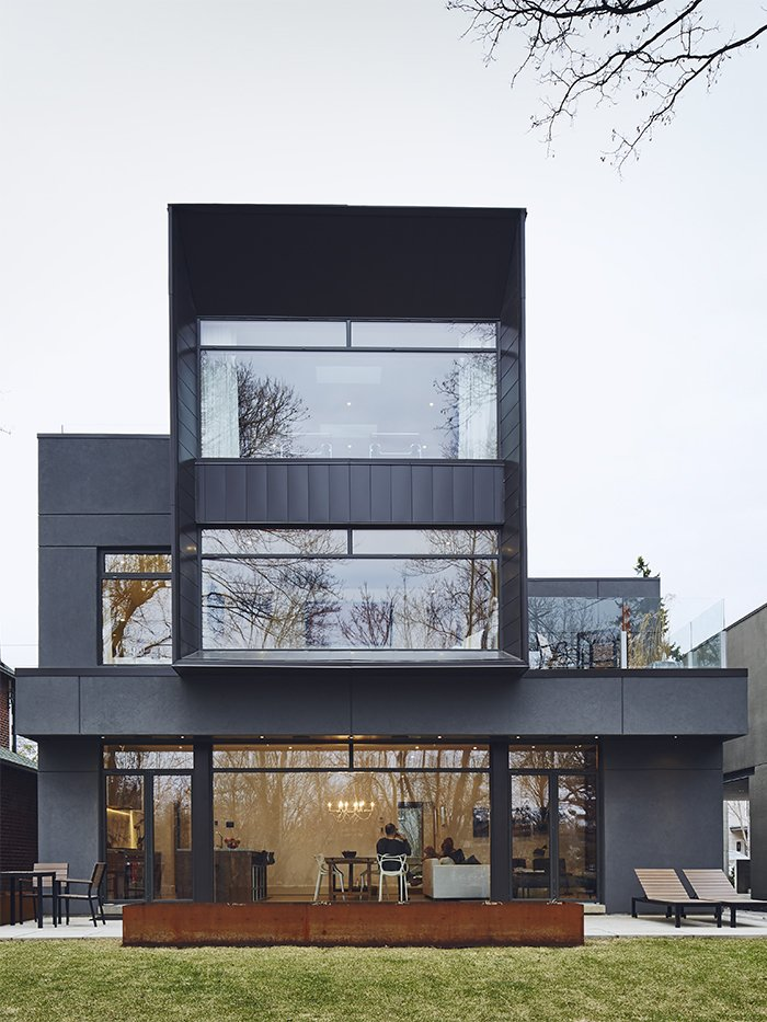 Exterior, Flat RoofLine, Metal Siding Material, and House Building Type When the Casali family gave Michael Krus and Prishram Jain of TACT Architecture free rein to work with unconventional materials, the architects responded by creating a geometric 4,300-square-foot smart home encased in aluminum panels by Agway Metals.  Photo 1 of 10 in On a Peaceful Wooded Lot, a Futuristic Toronto Home is Buzzing with Smart Tech