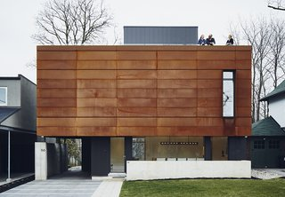 When the Casali family gave Michael Krus and Prishram Jain of TACT Architecture free rein to work with unconventional materials, the architects responded by creating a geometric 4,300-square-foot smart home encased in aluminum panels by Agway Metals. The front facade features Cor-Ten steel fabricated by Praxy Cladding.