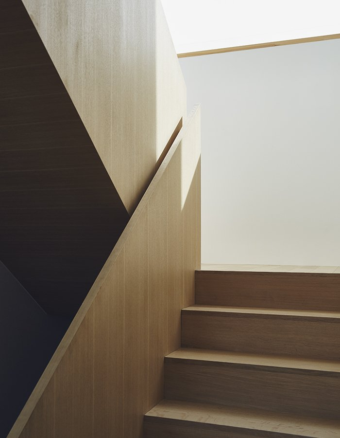 Staircase, Wood Tread, and Wood Railing Wood is used throughout the home, as in a sculptural staircase designed by TACT.  190+ Best Modern Staircase Ideas from On a Peaceful Wooded Lot, a Futuristic Toronto Home is Buzzing with Smart Tech