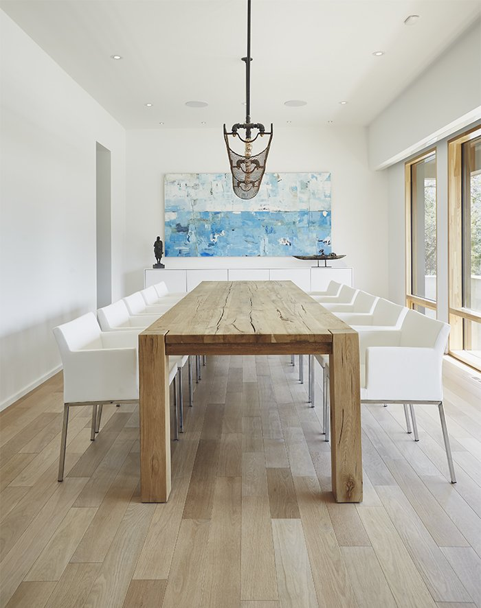Dining Room, Pendant Lighting, Ceiling Lighting, Chair, Storage, and Table The floors are gray-stained white oak, and the dining room table is from Restoration Hardware.  Photo 5 of 10 in On a Peaceful Wooded Lot, a Futuristic Toronto Home is Buzzing with Smart Tech