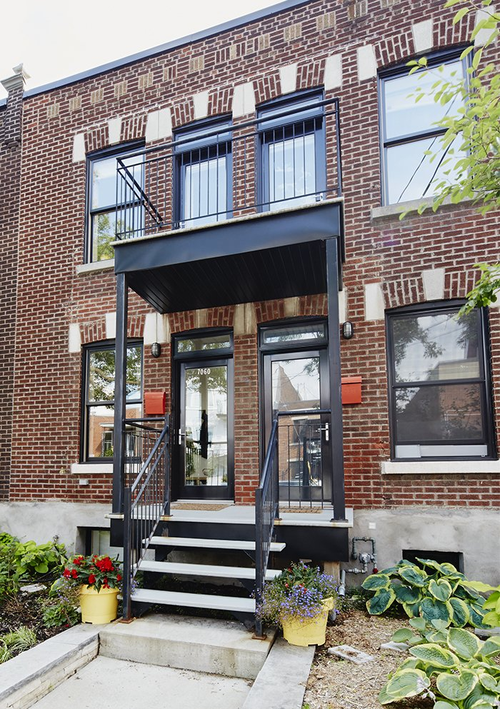 Exterior, House Building Type, Flat RoofLine, and Brick Siding Material The homeowners wanted to keep the traditional quadruplex structure typical of the Petite-Patrie neighborhood, but transform it into a spacious family home plus rental unit.  Photo 3 of 11 in An Architectural Mishmash in Montreal Becomes a Long-Term Family Home