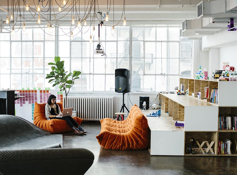 Living Room, Sofa, and Pendant Lighting New York firm MCDC designed littleBits's Chelsea office, which is outfitted with Togo sofas from Ligne Roset and an overhead fixture by Tech Lighting. The shelves hold books and play materials like Legos and K'nex.  Best Photos