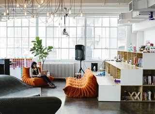 New York firm MCDC designed littleBits's Chelsea office, which is outfitted with Togo sofas from Ligne Roset and an overhead fixture by Tech Lighting. The shelves hold books and play materials like Legos and K'nex.