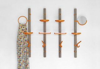 Cranbrook Academy of Art graduate Matthew Plumstead made his debut at ICFF with his configurable wood and rubber Clip Tree Valet, kitted out with clip-on rubber hooks, shelves, and widgets for holding domestic detritus. $225 at McCartyQuinn.