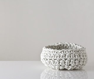 Neo's crocheted baskets are made of neoprene rubber, a material which is used frequently in plumbing and the motorcycle industries. $89 at Gretel Home.
